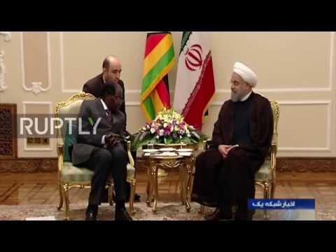 Iran: Rouhani And Zimbabwe's Mugabe Hold Private Bilateral Meeting In Tehran