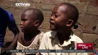Ugandan Youth Sheltering Orphaned Children