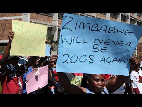 Zimbabwe Police Break Up Harare Protests With Tear Gas & Water Canon
