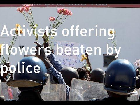 Activist Offering Flowers Beaten By Zimbabwe Police
